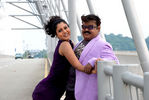 Sheryl Pinto with Vijayakanth in Arasangam