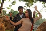 Jayam Ravi and Kangana Ranaut in Dhaam Dhoom Movie