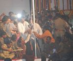 "Chiranjeevi hoisting the ""Praja Rajyam"" party flag"