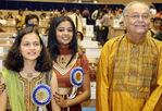 Winner of the 'Best Actor' award Soumitra Chatterjee with Priyamani winner of the Best Actress award and Divya Chaphadkar, the Best Child Artist award winner.