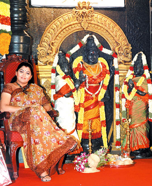 Kushboo wearing chappals in front of idols of goddesses at a film