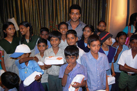 Shriya-Saran-and-surya-at-Joy-of-giving-week-2.jpg