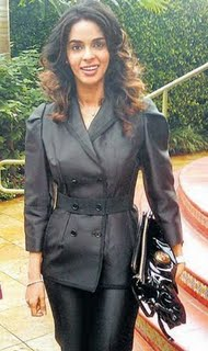 All-covered-up-rare-Picture-of-Mallika-Sherawat.jpg