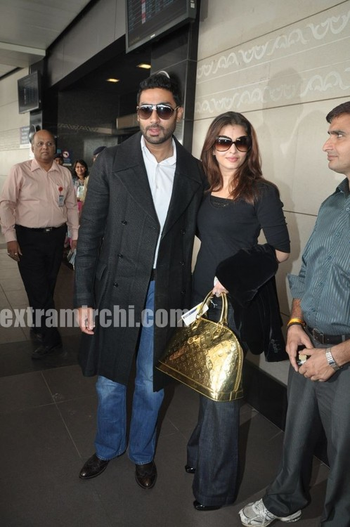 Aishwarya-Rai-and-Abhishek-Bachchan-leave-for-Raavan-Promotions-in-London.jpg